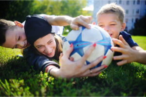mom and kids playing sports