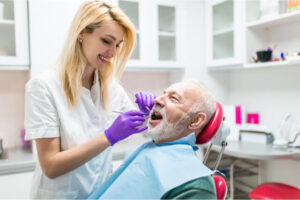 The senior patient has a regular dental visit.
